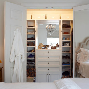 Inspiration for a transitional women's reach-in closet remodel in New York with recessed-panel cabinets and white cabinets