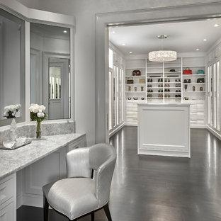 Walk-in closet - mediterranean women's dark wood floor and brown floor walk-in closet idea in Chicago with white cabinets