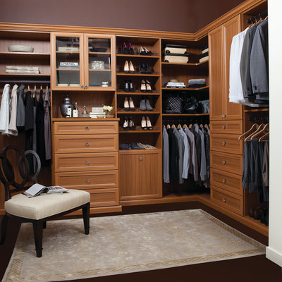 Example of a large classic gender-neutral dark wood floor and brown floor dressing room design in Orlando with open cabinets and medium tone wood cabinets