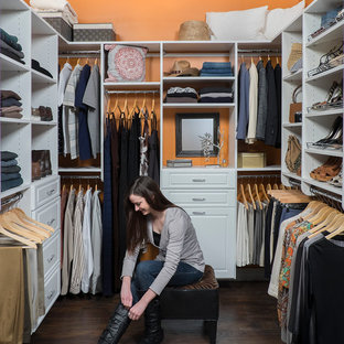 Photo of a large traditional gender-neutral walk-in wardrobe in Other with raised-panel cabinets and white cabinets.