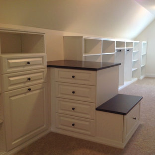 Example of a large classic gender-neutral carpeted walk-in closet design in Chicago with raised-panel cabinets and white cabinets