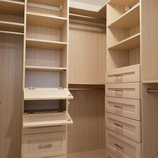 Small minimalist gender-neutral light wood floor walk-in closet photo in New York with shaker cabinets and light wood cabinets