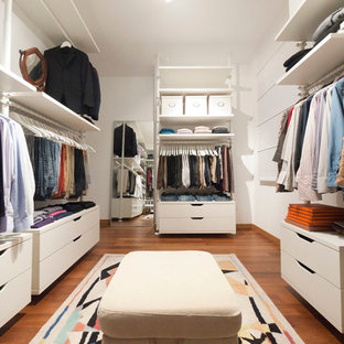 Inspiration for a mid-sized modern storage and wardrobe in Milan.