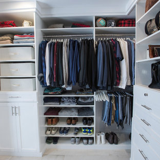 Inspiration for a mid-sized transitional terra-cotta floor walk-in closet remodel in Los Angeles with shaker cabinets and white cabinets