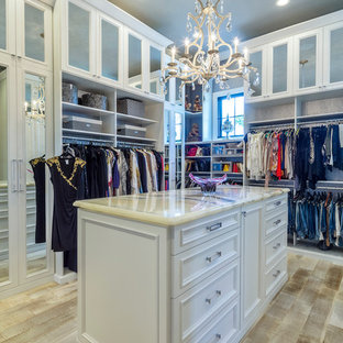 Large transitional gender-neutral light wood floor walk-in closet photo in Los Angeles with white cabinets and recessed-panel cabinets