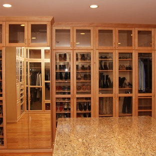 Photo of a large transitional gender-neutral walk-in wardrobe in Los Angeles with light wood cabinets.