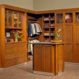 Inspiration for a mid-sized transitional gender-neutral walk-in closet remodel in Los Angeles with light wood cabinets and shaker cabinets