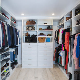 Mid-sized transitional terra-cotta floor walk-in closet photo in Los Angeles with shaker cabinets and white cabinets