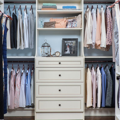 Walk-in closet - mid-sized transitional gender-neutral dark wood floor walk-in closet idea in Boston with recessed-panel cabinets and white cabinets