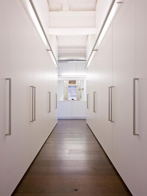 Walk-in closet - contemporary dark wood floor walk-in closet idea in DC