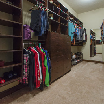 Walk-in closet with built in shelves for organization