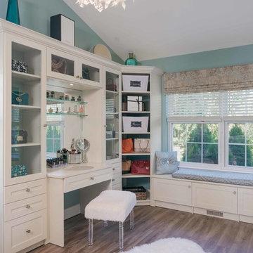 Walk-In Closet With Corner Shelves and Glass Doors