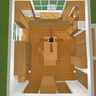 Esempio di una grande cabina armadio unisex moderna con ante lisce, ante in legno scuro e parquet chiaro