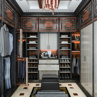 Inspiration for an asian men's ceramic floor and beige floor walk-in closet remodel in Los Angeles with flat-panel cabinets