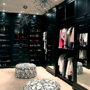 Design ideas for a contemporary dressing room in Vancouver with black cabinets and carpet.