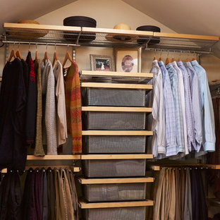 Example Of A Classic Gender Neutral Dark Wood Floor Closet Design In Seattle