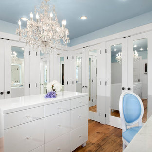 Dressing room - transitional medium tone wood floor dressing room idea in Vancouver with white cabinets
