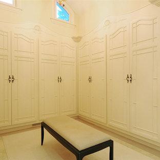 Foto de armario y vestidor unisex, mediterráneo, con puertas de armario beige y suelo de piedra caliza