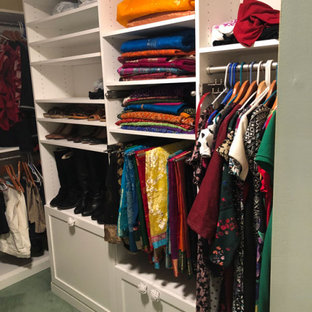 Example of a mid-sized transitional women's carpeted and green floor dressing room design in Other with shaker cabinets and white cabinets