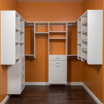 White Raised Panel Walk In Orange Closet
