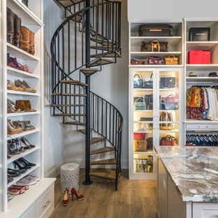 Walk-in closet - transitional women's dark wood floor and brown floor walk-in closet idea in Houston with open cabinets and white cabinets