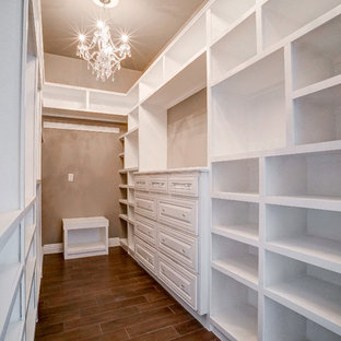 Mid-sized traditional gender-neutral walk-in wardrobe in Austin with open cabinets, white cabinets and porcelain floors.