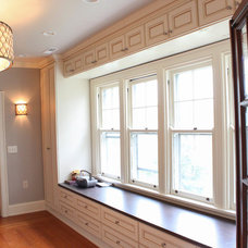 Traditional Closet by Essence Design Studios