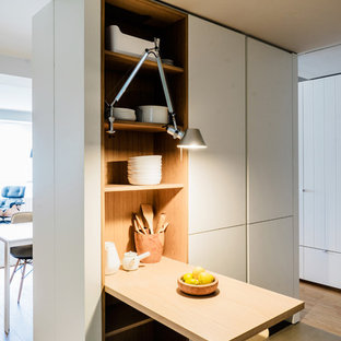 Small scandinavian l-shaped open plan kitchen in Madrid with an undermount sink, flat-panel cabinets, white cabinets, quartz benchtops, white splashback, glass sheet splashback, panelled appliances, ceramic floors and no island.