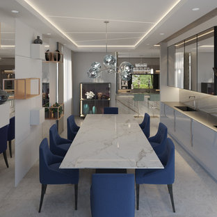 Photo of a mid-sized modern single-wall eat-in kitchen in Barcelona with an integrated sink, glass-front cabinets, grey cabinets, glass benchtops, black appliances, ceramic floors, no island, grey floor and grey benchtop.