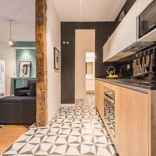 Small contemporary open concept kitchen ideas - Example of a small trendy single-wall ceramic floor open concept kitchen design in Madrid with flat-panel cabinets, light wood cabinets, black backsplash, subway tile backsplash, no island, marble countertops and stainless steel appliances
