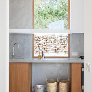 Inspiration for a large contemporary single-wall separate kitchen in Other with concrete benchtops, an integrated sink, flat-panel cabinets, medium wood cabinets, grey splashback, cement tile splashback, stainless steel appliances, concrete floors and no island.