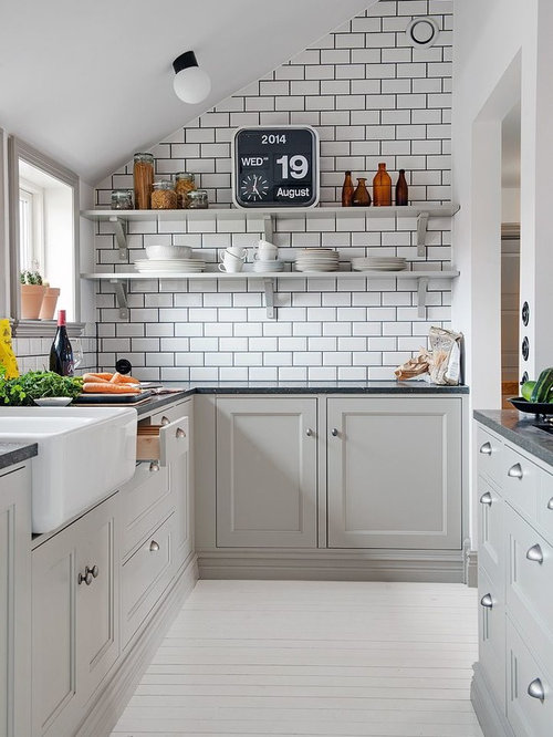 small farmhouse galley enclosed kitchen idea in madrid with a farmhouse sink recessed panel - Kitchen Design Ideas Pictures