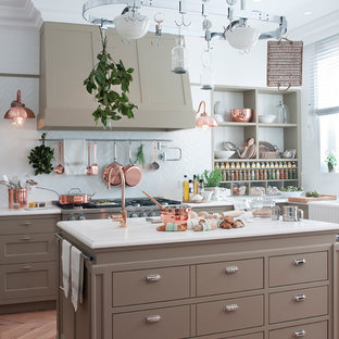 Design ideas for a large transitional eat-in kitchen in Barcelona with an integrated sink, beige cabinets, quartz benchtops, white splashback, ceramic splashback, stainless steel appliances, light hardwood floors, with island, brown floor, flat-panel cabinets and white benchtop.