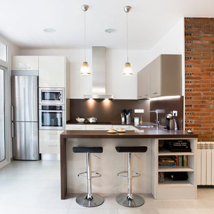 Inspiration for a mid-sized contemporary u-shaped separate kitchen in Barcelona with an undermount sink, flat-panel cabinets, white cabinets, brown splashback, stainless steel appliances, a peninsula, solid surface benchtops and ceramic floors.