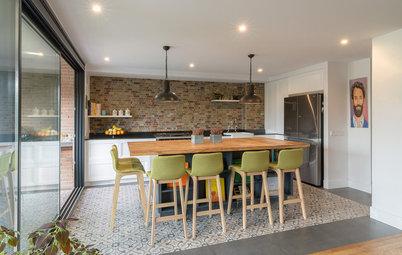 Una amplia cocina de estilo americano en un piso en Madrid