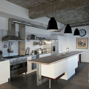 Design ideas for a large industrial single-wall open plan kitchen in Madrid with a double-bowl sink and with island.