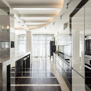 Diseño de cocina lineal, actual, abierta, con armarios con paneles lisos y una isla