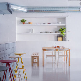 Large industrial eat-in kitchen remodeling - Eat-in kitchen - large industrial galley ceramic floor eat-in kitchen idea in Barcelona with open cabinets, white cabinets, stainless steel countertops, blue backsplash, stainless steel appliances and an island