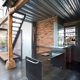 Inspiration for an industrial single-wall open plan kitchen in Other with an undermount sink, open cabinets, stainless steel benchtops and a peninsula.