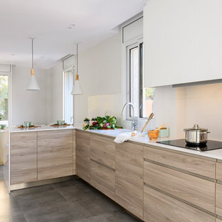 This is an example of a mid-sized contemporary l-shaped eat-in kitchen in Other with an undermount sink, flat-panel cabinets, quartzite benchtops, white splashback, limestone splashback, stainless steel appliances, ceramic floors, a peninsula, grey floor, white benchtop, recessed and light wood cabinets.