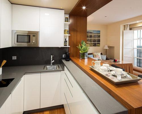 foto de cocina en u moderna pequea abierta con armarios con paneles