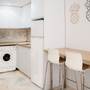 Inspiration for a small scandinavian l-shaped open plan kitchen in Madrid with a single-bowl sink, flat-panel cabinets, white cabinets, laminate benchtops, beige splashback, ceramic splashback, white appliances, marble floors, no island, white floor and brown benchtop.