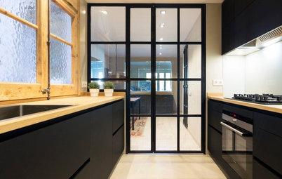 Cocinas negras modernas: ¡Acierta con un toque cálido!