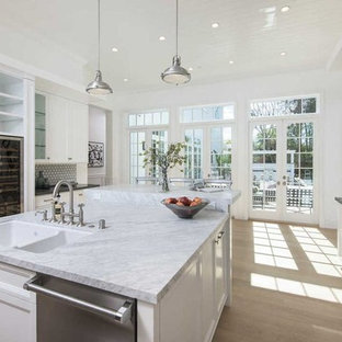 Inspiration for a large contemporary u-shaped open plan kitchen in Los Angeles with a double-bowl sink, open cabinets, white cabinets, quartzite benchtops, multi-coloured splashback, glass tile splashback, stainless steel appliances, light hardwood floors, with island, beige floor and multi-coloured benchtop.