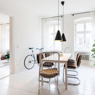 Foto de comedor nórdico con paredes blancas, suelo de madera pintada y suelo blanco
