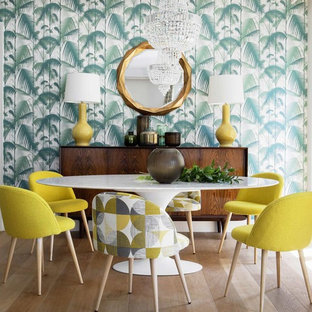 Inspiration for a tropical dining room in Other with multi-coloured walls, light hardwood floors, no fireplace and beige floor.