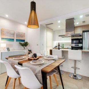 Foto de comedor de cocina contemporáneo, sin chimenea, con paredes blancas y suelo beige