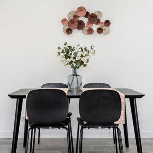 Diseño de comedor contemporáneo, de tamaño medio, con paredes blancas, suelo de baldosas de porcelana y suelo gris