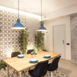 バルセロナの中サイズのインダストリアルスタイルのおしゃれなダイニングキッチン (グレーの壁、グレーの床、コンクリートの床) の写真