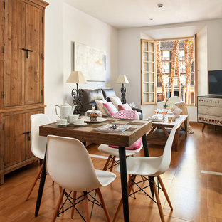 Inspiration for a mid-sized shabby-chic style open plan dining in Malaga with white walls, medium hardwood floors and no fireplace.